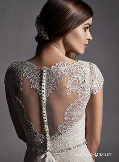 Delicate lace cap-sleeves and a gorgeous illusion back is found in this romantic A-line wedding dress, Jane by Sottero and Midgley.