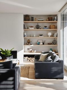modern living room design with modern gray sofas and coffee table decor, jute rugs asnd modern open shelf decor, modern open shelf styling next to modern fireplace in neutral family room decor Home Living Room, Interior Design Living Room, Living Room Designs, Living Room Decor, Living Spaces, Beach Interior Design, White House Interior, Beach Living Room, Australian Interior Design