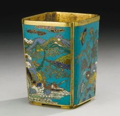 A SMALL CLOISONNE ENAMEL BRUSHPOT 17TH CENTURY of canted square section decorated with two landscape panels, one with a lone fisherman in a mountainous landscape, the other with a scholar and attendant crossing a bridge, and the remaining sides with flowers, lingzhi and butterflies, in bright yellow, green, blue, pink, aubergine, white and black enamels on a turquoise ground, all supported on four shaped feet Height 3 5/8 in., 9.3 cm