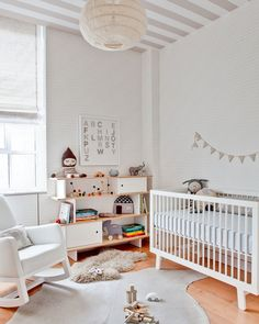 Clean, crisp modern nursery | oeuf furnishings + gray + white + striped ceiling