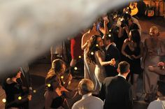 Michigan outdoor barn wedding with hanging lights. Bride and groom having a dance.