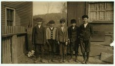"""These are all breaker-boys. (See photos taken at Ewen Breaker, later.) They were very suspicious of my motives. Sam Bellom (boy on left end of photo), 58 Pine Street. Been working in breaker #9 for two years, he says. He says, also, that he is 14 years old, but does not appear to be? Sam Topent (next to Bellom), 52 Pine Street. Been working at Ewen Breaker two years. Said, """"I'm fourteen years, an' if you don' believe me, I kin show you de proofs."""" (They were all suspicious.) This boy had…"""