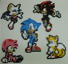 Perler bead magnets! I'd love to try making these pixel Sonic characters!