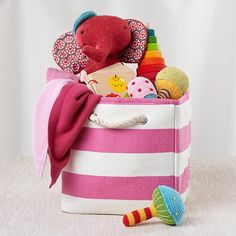 It's a girl! Our official baby gift bag includes a range of infant-safe goodies that will grow with the new arrival. What's more, mom gets a handy Stripes Around the Cube Bin out of the deal.