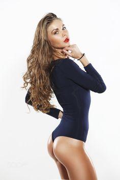 Beautiful  young woman - Beautiful sexy young woman with long brown hair studio shot.