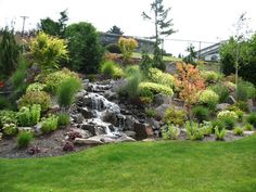 Steep Slope Landscaping Solutions On A Boulders backyard steep slope landscaping ideas. landscaping a small steep slope. landscaping a steep slope pictures. Backyard Hill Landscaping, Steep Hillside Landscaping, Landscaping With Boulders, Hillside Garden, Backyard Landscaping, Landscaping Ideas, Sloping Garden, Backyard Stream, Backyard Layout