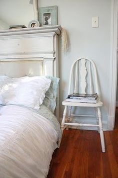 Fireplace mantel turned headboard, shabby chic chair as a night stand.