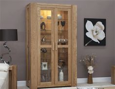 Chunky Oak Glass Display Cabinet from Furniture Plus Online. Browse our range of top quality Oak & Pine furniture. Light Oak Furniture, Glazing Furniture, Solid Oak Furniture, Pine Furniture, Glass Display Shelves, Oak Display Cabinet, Tall Cabinet Storage, Oak Furniture Superstore, Oak Sideboard