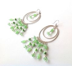 Silver tone large oval chandelier earrings with mint green crystals and glass beads