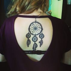 DReamcatcher tattoo down spine <3 i have a dreamcatcher on my back too love it