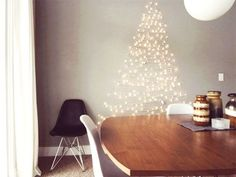 String Christmas lights on a wall in the shape of a Christmas tree! Creative Christmas Trees for Small Spaces Wall Christmas Tree, Creative Christmas Trees, Noel Christmas, Holiday Tree, Xmas Trees, Christmas Stockings, Homemade Christmas, Christmas Tree Cat Proof, Christmas Crafts