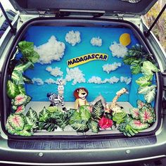 Trunk-or-Treating!  Use this idea, but use palm trees, brightly colored flowers and set up for 'beach party theme...