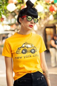 "The Lowdown: No reason to pick a side: we love New York City. Start spreading the #news in this vintage NYC graphic tee. Circa whenever taxis cost $2 initial charge (see the ""Fares"" listed on the back"