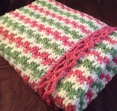 Soft pink, green, and white handmade baby blanket by HookYarnAndHooper on Etsy #hepteam #craftshout0112e