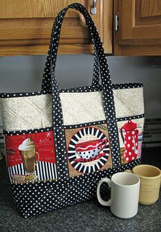 """A  Novel Approach PQD-184  19""""w x 15"""" h x 3½"""" deep with a 10"""" strap drop  Love that novelty fabric...what should I do with it? Make a statement with a bag that sports those novelty prints on all 6 pockets! Uses up to 6"""" square novelties!"""