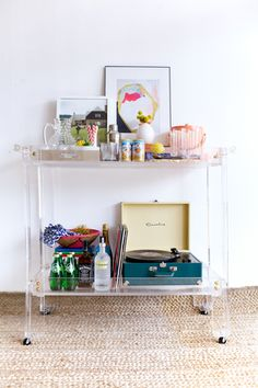 """This large Lucite Bar Cart with brass accents is a conversation piece and perfect for entertaining. Dimension: - Inside Tray Dimensions 43"""" W x 19"""" H - Outside Dimensions 51.5""""W x 21""""D x 36.75""""H Hand"""