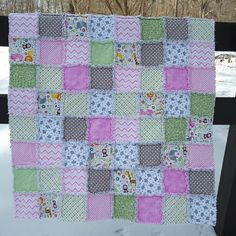 Pink and gray, elephants, baby rag quilt.  https://www.etsy.com/listing/268155696/rag-quilt-for-baby-girl-flannel