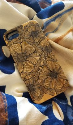 Poppies laser engraved bamboo wood iPhone case.