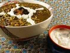 Aashe Reshteh - dense soup made from chickpeas, lentils, red and navy beans, noodle, fresh greens (parsley, cilantro, spinach, green onions, dill ) and as required in Persian cuisine – rich seasoning