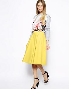 A bright yellow skirt pairs perfectly with a floral print top for spring! ASOS Full Midi Skirt In Scuba With Pockets, $65.87