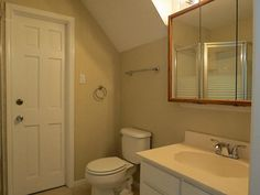 The downstairs bathroom is conveniently located just off the main entry hallway.