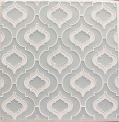 Stylish glass tile in a sleek geometric design.