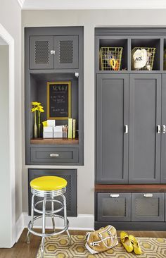 Lockers just off the kitchen create a drop zone for kids. An alcove message center along the same wall doubles as a desk when a stool is pulled up. gray with yellow accessories Drop Zone, Family Kitchen, Family Room, Command Center Kitchen, Kitchen Message Center, Kitchen Design, Kitchen Decor, Banquette, Kitchen Organization