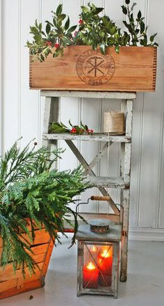step ladder, wooden crate with greens, lantern, christmas