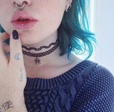 septum, philtrum and vertical labret piercings