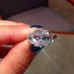 Three Stone Cushion Cut Engagement Rings