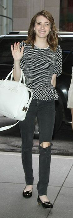 Who made  Emma Roberts' black and white top, white handbag, and cat flat shoes?