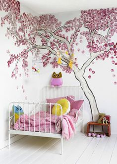 Future baby room. Mural tree - this is just too mesmerizing not to pin ... I came back to this three times before I gave in ... this mural tree has real tree branches painted white intermingled and used as shelves of sorts.  If I can scale this down a bit, I may put it in the kids bathroom and use the branches for towel hangers.