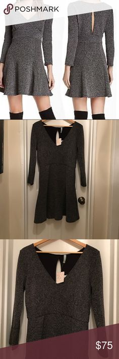 Free People Knit Skater Dress- Black Tweed Free People Knit Skater Dress- Black Tweed - Fit and flare style - 3/4 Sleeve- detail hole in the back Free People Dresses