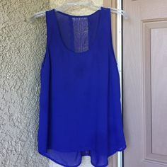 Royal Blue Lace Tank Top Really pretty color and nice lace backing. However there is spotting in the front. Also, tank is fully lined. All $3 & $4 items are buy 1 get 1 Free. If they don't sell within a week, they go to donation.  Tops Tank Tops