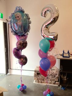 Elsa from Frozen stars in these 2nd birthday balloon decorations for a very lucky girl! The #frozen bouquet also has 2 extra happy birthday balloons with Anna and Elsa and lavendar heart foils - absolutely gorgeous!