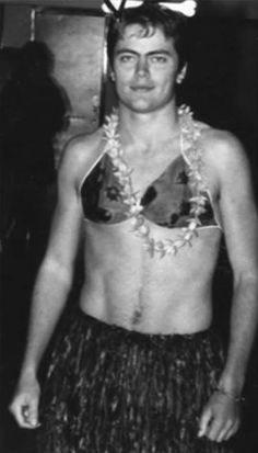 Behold, a young Nick Offerman (aka Parks and Rec 's uber-macho man, Ron Swanson) looking pretty good dressed up as a hula girl.
