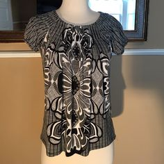 Style & Co black and white blouse Black and white, cap sleeve blouse. Gathered along the neckline. 95% polyester, 5% spandex. Beautiful condition.  Petite size. Style & Co Tops Blouses
