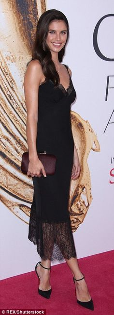 Evening look: Model Sara Sampaio looked fantastic in a simple lace-trimmed little black dr...