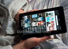 Using a Amazon Kindle Fire tablet Royalty Free Stock Photo