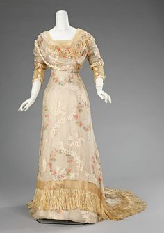 A dinner dress dating from between 1910 and 1912. I love the fringe on the train.