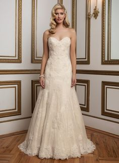 Beaded Venice lace over Chantilly lace grace this classic sweetheart neckline A-line gown and is finished with scalloped lace hem. 8839