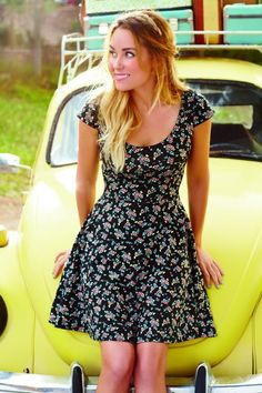LC in a floral dress