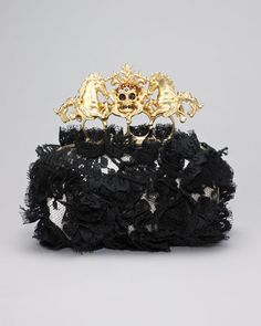 "Lace Unicorn & Skull-Clasp Clutch by Alexander McQueen at Neiman Marcus.Black floral lace embroiders nude satin.  Golden brass knuckle clasp with pave crystal skull and symmetric unicorns.  Golden metal frames structured, rounded silhouette.  Hinge-snap closure.  Leather lining.  4""H x 6 1/4""W x 2""D.  Handcrafted in Italy."