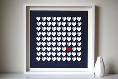 3D wedding guest book art piece, with hearts for names; size small. Includes frame and such, and colors are customizable. This is the recommended size for 100. ($180)