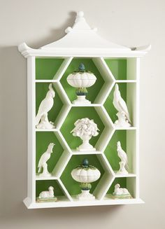 pagoda curio shelf.  white and  green.  collection.