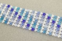 Learn Melanie de Miguel's Hubble bead stitch in. We recorded the live webinar that she did at Bloomin Beads and now you can watch and learn from home. First you'll learn her new Hubble Stitch and then you'll use those techniques to make her fabulous Enchanted Forest bracelet