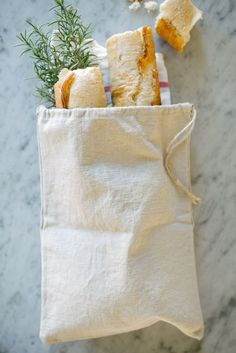 100% natural linen is a beautiful and breathable way to store your breads, bagels, rolls and more. Makes a thoughtful hostess gift and is a rustic way to present bread for special occasions.  Each bag is made of natural (beige) linen with a jute drawstring. Measures 9.5 x 13.5.  Hand or machine wash (delicate cycle) using cold water.  Listing is for one bag.