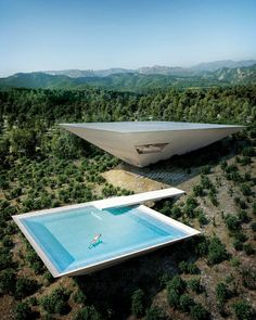 It looks like a Bond villain's mountain lair, but the flipped form is practical, providing ample shade in the hot Mediterranean climate.