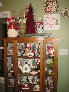 """Spode Christmas China replaced my Fiesta Ware dishes for the holiday season.  In order to make the dish display more """"fun"""", I decided to combine my old Santas and framed Santa pictures into the mix."""