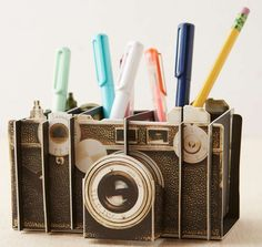 A pencil holder that any photographer will love. | 35 Insanely Awesome And Inexpensive Things You Need For Your Desk